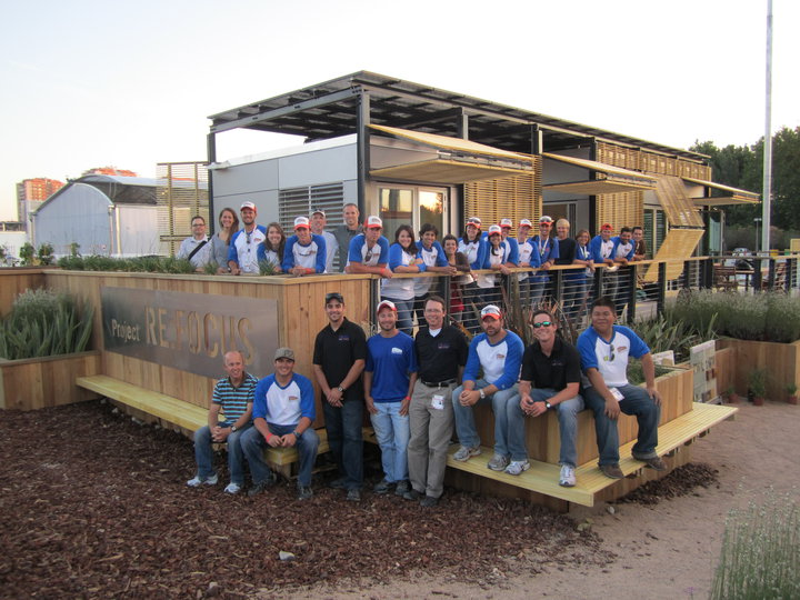 "Figure 3. Team Re-Focus"" poses for a photo with their modular home entry in the Solar Decathlon Europe 2010 competition. Credit: University of Florida - http://solardecathlon.ufl.edu/ and http://www.facebook.com/photo.php?fbid=403694283322&set=a.445990738322.236763.105061853322."