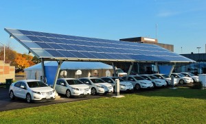 Figure 4. Vehicles charging with solar power. Credit: Sass Peress, Renewz Sustainable Solutions Inc., via Wikimedia Commons