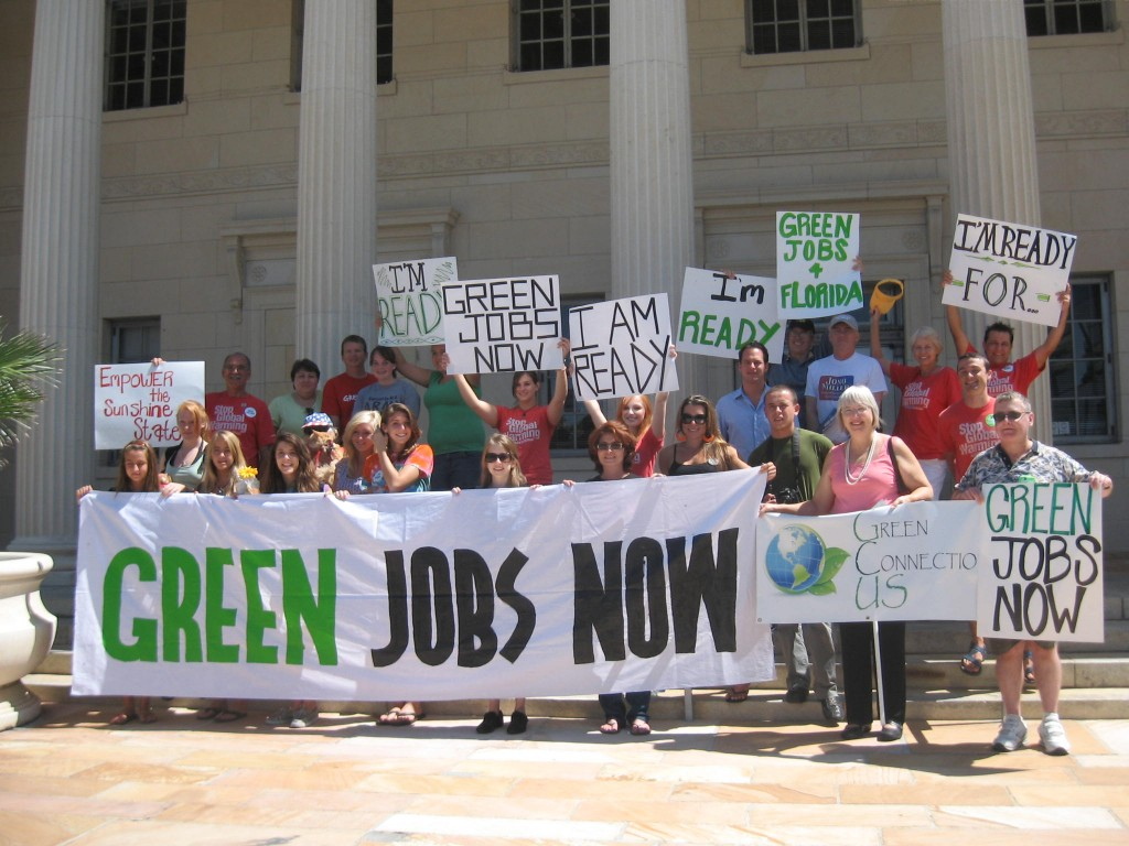 "Figure 1. Voters in Sarasota, Florida call for Green Jobs Now on the steps of the Federal Building. Credit: Flickr user ""greenforall.org"" via CC By-NC-SA 2.0 License – http://www.flickr.com/photos/green4all/2907164433/"