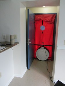 A blower door test set-up on a new home as it appears from the inside of the building. Credit: PREC