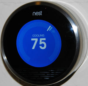 "Figure 4 Image of an installed learning thermostat. Credit: <a title=""A smart thermostat"" href=""https://en.wikipedia.org/wiki/Nest_Labs#/media/File:Nest_front_official.png"" target=""_blank"">Wikimedia Commons, CC BY-SA 3.0</a>."